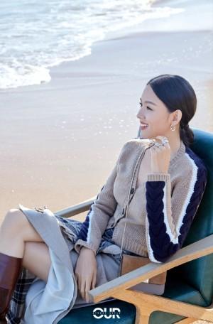 张梓琳针织开衫清新海边写真图片