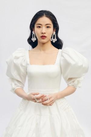 SNH48孙芮素净白裙优雅迷人写真图片